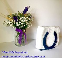 This Horseshoe Napkin Holder will be the conversation every time you have guest in your kitchen, or in your bar or restaurant. I love this piece. I purposely put the horseshoes facing up, to hold your good luck in.   You can use this as a napkin holder, a book holder, a letter holder, a recipe holder, or for anything else you can imagine. This beautiful piece of rustic kitchen decor would make a wonderful Christmas, birthday, anniversary, wedding, or just because gift. The napkin holder in…