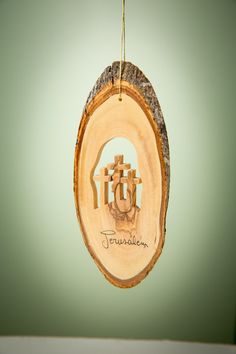 Hand-carved in Bethlehem from Olive Wood.