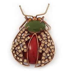 Gumbo Swarovski Crystal Semiprecious Stone 'Bug' Brooch In Copper Finish - 8.5cm Length Avalaya. $63.00. Theme: insect. Metal Finish: copper. Collection: insect. Gemstone: swarovski crystal. Occasion: anniversary, cocktail party, going to theatre