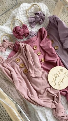 Baby Names Discover You NEED these in your hospital bag! Shop Baby girl Knotted Gowns & Photo Props These buttery soft knotted gowns come with a matching knotted hat and a HUGE collection of coordinating swaddles mommy robes and wood engraved signs!