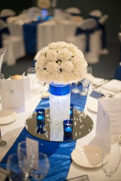 Can get plain white or ivory linens (if cheaper) and accent with blue table runners and sashes. Royal Blue wedding centre piece