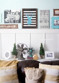 Decorating with family pictures gallery wall- cute rugby striped deer head sign!