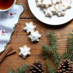 A favorite family recipe, zimtsterne are moist and nutty, cinnamon-spiced cookies glazed with crunchy meringue. And, they're naturally gluten free! German Christmas Cookies, Noel Christmas, Cookie Glaze, Spice Cookies, Cinnamon Spice, Cookies Et Biscuits, Gluten Free Recipes, Cookie Recipes, Yummy Food