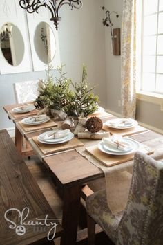 Rustic Christmas tablescape - DIY wood chargers, giant pinecones, birch logs