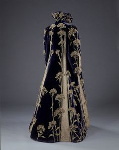 Woman`s coat. Deep purple velvet with cream embroidered silk. England, c.1895