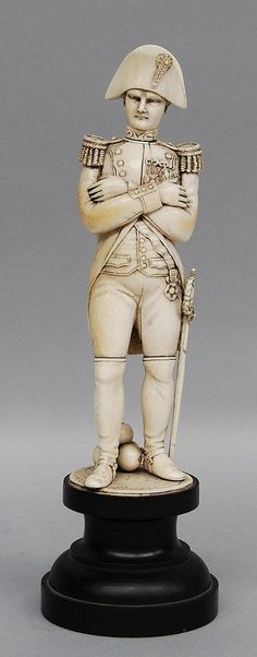 An ivory carved Bonaparte figure on a wooden base, Dieppe, 1