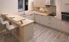 L'électroménager ainsi que les poignées grises anthracites se fondent parfaitement dans cette cuisine en U faite entièrement de bois et de blanc cassé