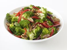 In this five minute side, broccoli gets a kick from red chile flakes; walnuts add crunch.