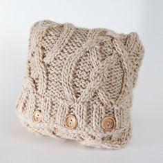 Cable knit pillow.  Love the buttons.