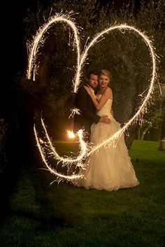 Wedding photo shooting with sparklers creating a heart and long time exposure © www.finestweddingphotography.com Susi Nagele Hochzeitsfotografie | Finest wedding photographer Austria | Vienna  Hochzeitsfotograf Wien Hochzeit Österreich