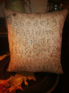 what's not to love?  folk art. pillow. alphabet.  I've got to make this.