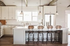 Pneumatic Addict : Gorgeous Ranch Style Remodel - like the island with inset area for stools