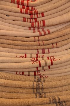Antique and handmade linen rolls and grain sacks. Welcome to our world of unique and changeless antique textile treasures.
