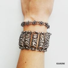 Traditional-style handmade filigree bracelet made from silver with a modern-filigree flower bracelet.  Feel free to email us with any requests at kanini.jewelry@gmail.com.  We look forward to hearing from you!  #jewelry #silver #handmadejewelry #handmade #artistic #art #limited #limitededition #filigree #filigrana #filigran #bangle #cuff #bracelet #pretty #fashion