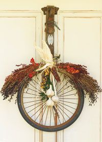 Clever idea for turning castoffs into door-stopping autumnal projects. Sue Whitney and Ki Nassauer from JunkMarket show you how.   WHEELING AROUND: To whip up a classic front-door wreath with an old, squeaky wheel, Sue and Ki hung an old leather logger's belt from a sturdy vintage drawer pull drilled into a door. Loop the belt end through a vintage wheel. You may need to snip off a spoke or two. (If desired, use self-stick surface protectors on back of wheel to protect door from scratches.) W...