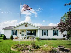 American ranch home with flag pole and garden in front yard. #RealEstate
