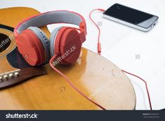Relaxing Time. Red Earphone On Guitar Connect With Smart Phone Over White Background Stock Photo 323623571 : Shutterstock