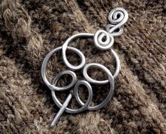 Celtic Knot Shawl Pin , Scarf Pin - Swirling Flower Aluminum Wire. $22.00, via Etsy.