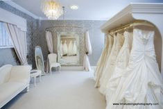 bridal salon decor, with chair, full length mirrors, settee