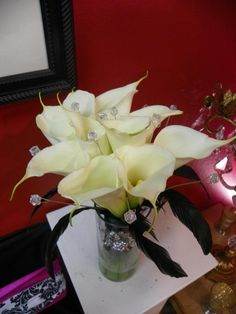 Calla Lily Bouquet with Crystals and Black Rooster Feathers. Calla Lily Bridal Bouquet, Bridal Bouquets, Black Rooster, Rooster Feathers, Calla Lillies, Boutonnieres, Table Centerpieces, Crystals, Beach