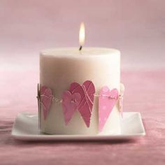 This is a cute idea, just cut up heart shapes from scrapbook paper and wire together to form a circle around candle.  You could do different ones for every holiday/season.