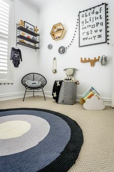mini style.  Love the tan carpet with navy rug over, and the white / light gray walls, with lots of wood & black accents.