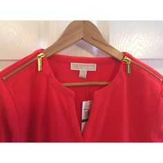 Michael Kors Red/Orange Top Michael Kors reddish orange top with zipper detailing on shoulders. Three quarter length sleeves and a small v-neck cut. NWT! Perfect condition! No trades please!  let me know if you have questions ❓ and make me an offer!!  happy shopping!   All items from a smoke free home! MICHAEL Michael Kors Tops Tees - Long Sleeve