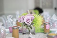 Beautiful flowers and table setting at the bridal shower.
