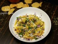 papdi chaat recipe, dahi papri chaat, chaat papri with step by step photo/video. popular street food of india, fast food of north india from crisp flat puri