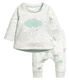 Light gray/cloud. CONSCIOUS. Top and pants in melange jersey made from organic cotton. Top with snap fasteners on one shoulder and printed motif at front.
