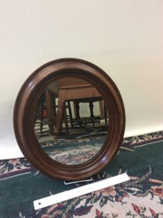 BEAUTIFUL VINTAGE WALNUT OVAL MIRROR WITH DOVE TAIL JOINERY. THE MIRROR HAS A DEEP FRAME AND RICH COLOR. 16H X 14W X 2D