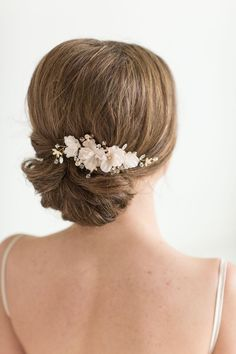 Bridal Hair Comb This hair comb is completely hand wired and embellished with pretty metal enameled flowers, crystals and rhinestones. The