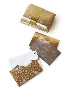 "<p> </p> <p>Set of 12 Christian Lacroix 'Oro Y Plata' Correspondence Cards</p> <p class=""""p1"""">As beautiful as you'd expect from the designer, these cards are created with exacting laser cuts and use gold foil and embossing techniques. The envelopes are gorgeous on the interior and the  gold foil correspondence cards have a contrasting ivory to reverse.</p> <p class=&quot..."