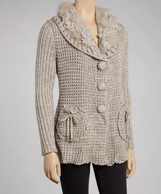 Slip into this cozy-chic cardigan for an instant hit of warmth that doesn't skimp on the wow factor. With its fiercely feminine silhouette and trend-savvy touches, this lovely layer makes a sweet staple.Measurements (size XL): 27'' long from high point of shoulder to hem45% wool / 40% polyester / 15% acrylicHand wash; dry flatImported