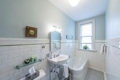 Cottage Full Bathroom with Flush, High ceiling, Wall mounted sink, Glass panel, flush light, penny tile floors