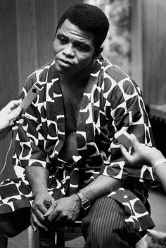 Eve Arnold USA. New York. African Americans. James Brown; singer, being interviewed after a concert in the Apollo in Harlem where the slogan 'Black is Beautiful' was introduced. 1968.