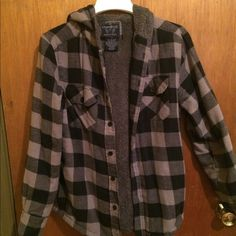 Plaid hooded flannel coat Oversized button down, hooded flannel coat. Super warm, has a soft furry lining in it, with buttoned sleeves Jackets & Coats Utility Jackets
