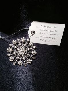 Brooch with tag