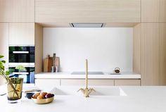 Juma Architects. Campana integrada en mueble alto
