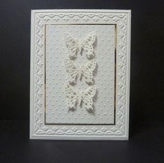 white on white card with butterfly trio...lovely...
