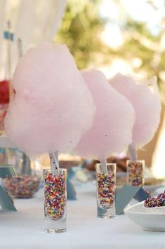 pink cotton candy centerpieces in shot glasses filled with sprinkles