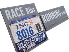 Race bibs and RUNNING medals display: Running On The Wall