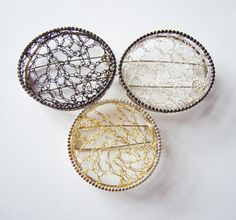 Frame brooches, Audrey Reid