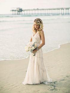 20 Dreamy Beach Wedding Dresses | SouthBound Bride | http://www.southboundbride.com/dreamy-beach-wedding-dresses | Credits:  Amy Lynn Photography/Beau & Arrow Events/Jenny Packham via 100 Layer Cake