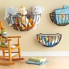 Small baskets can be hung on a wall to conveniently hold toys or books - for narrow wall in kitchen?