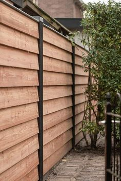 black and wood accent gate with lattice from illusions fence It feels wonderful having a beautiful patio or backyard garden, but you still need some privacy fence on your own home. That's why it's necessary to have an outdoor privacy scre Privacy Screen Outdoor, Backyard Privacy, Backyard Fences, Garden Fencing, Backyard Landscaping, Privacy Fence Landscaping, Outdoor Fencing, Backyard Ideas, Cedar Fence