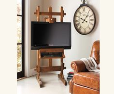 Isn't this a fabulous idea for 'hanging' your TV?  Most TV stands are boring and generic but this is so unique!  Problem is we have other units that go with the TV, like the a DVD player and stereo receiver, plus the computer we've hooked up so we can watch stuff online - where does that all go?  European Easel TV Stand