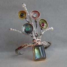 Cuff Bracelet by Sandra Dini . Silver, red gold 12kt, green sapphire, green tourmaline, aquamarine, ruby, pearl.