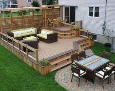 this two level deck design creates an eating area and a sitting area