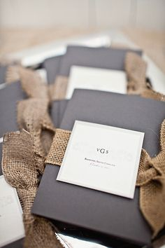 Find beauty with burlap — ceremony programs with rustic details.